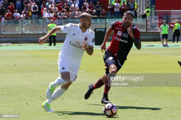 Marco Boriello of Cagliari in contrast with GAbriel Paletta of Milan during the Serie A match between Cagliari Calcio and AC Milan at Stadio...