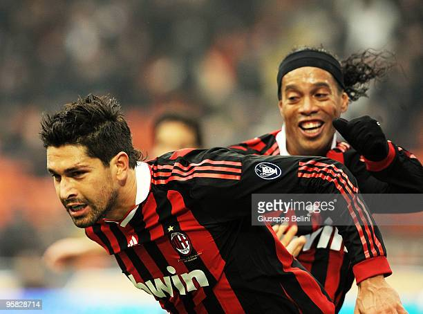 Marco Borriello and Ronaldinho of Milan celebrate the goal during the Serie A match between Milan and Siena at Stadio Giuseppe Meazza on January 17...