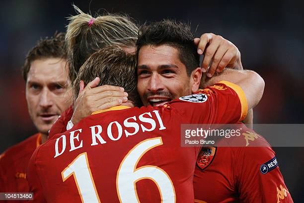 Marco Borriello of AS Roma celebrates with Daniele De Rossi after scoring their team's 20 goal during the UEFA Champions League group E match between...