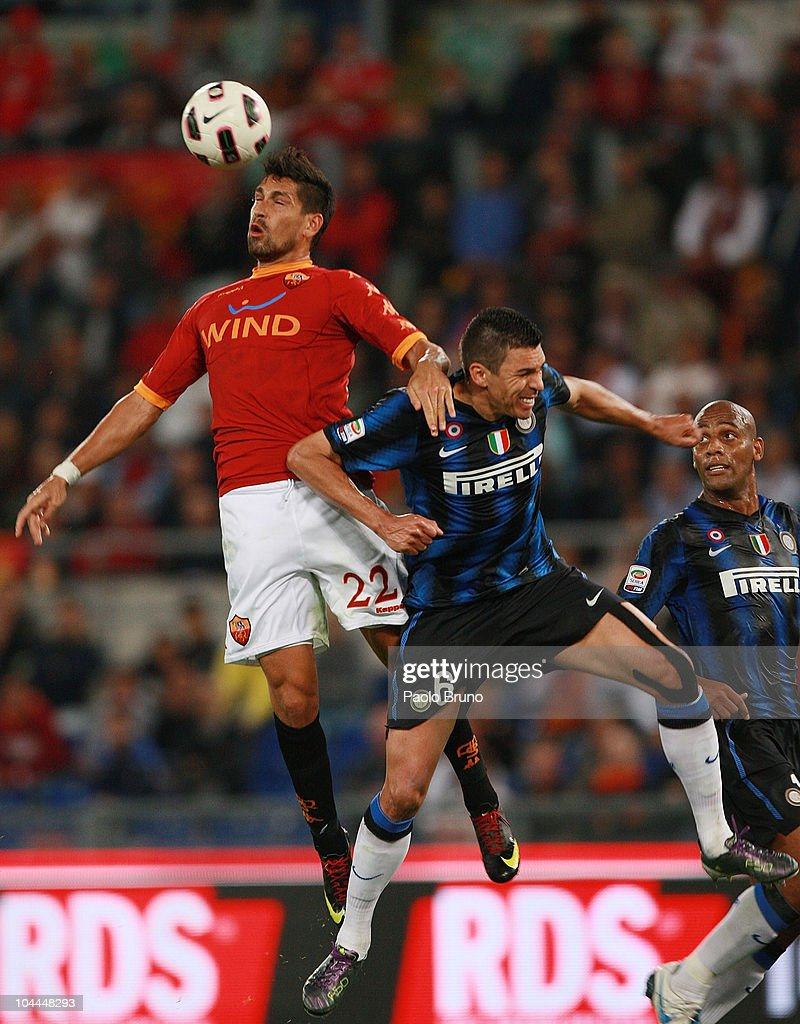 Marco Borriello of AS Roma (L) goes up for a header against Lucio of Internazionale Milano during the Serie A match between AS Roma and FC Internazionale Milano at Stadio Olimpico on September 25, 2010 in Rome, Italy.