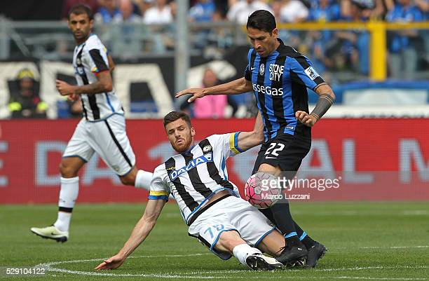 Marco Borriello of Atalanta BC competes for the ball with Thomas Heurtaux of Udinese Calcio during the Serie A match between Atalanta BC and Udinese...