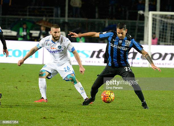 Marco Borriello of Atalanta BC competes with Lorenzo Tonelli of Empoli FC during the Serie A match between Atalanta BC and Empoli FC at Stadio Atleti...