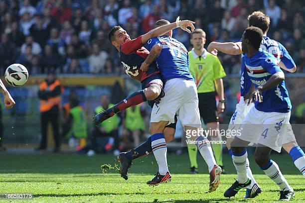 Marco Borriello of Genoa CFC is tackled by Angelo Palombo of UC Sampdoria during the Serie A match between Genoa CFC and UC Sampdoria at Stadio Luigi...