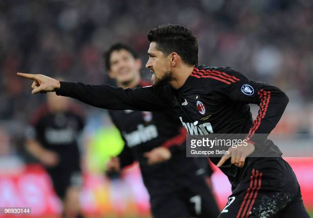 Marco Borriello of Milan celebrates the opening goal during the Serie A match between AS Bari and AC Milan at Stadio San Nicola on February 21 2010...