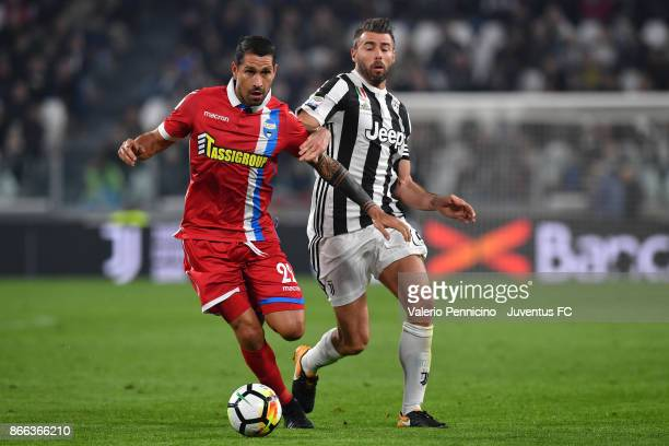 Marco Borriello of Spal and Andrea Barzagli of Juventus compete for the ball during the Serie A match between Juventus and Spal on October 25 2017 in...