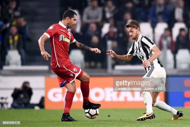 Marco Borriello of Spal and Daniele Rugani of Juventus compete for the ball during the Serie A match between Juventus and Spal on October 25 2017 in...