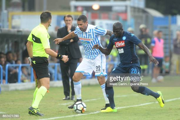Marco Borriello of Spal competes the ball with Kalibou koulibaly of SSC Napoli during the Serie A match between Spal and SSC Napoli at Stadio Paolo...