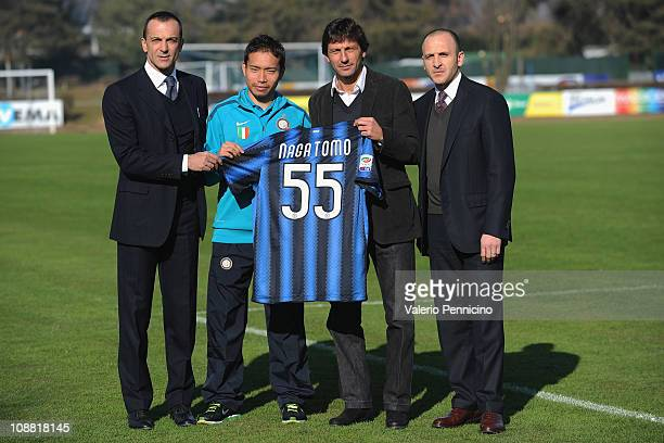Marco Branca Yuto Nagatomo Leonardo and Piero Ausilio pose together as Yuto Nagatomo signs for FC Internazionale Milano at Centro Sportivo Angelo...