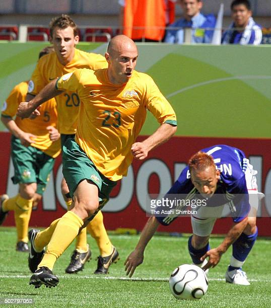 Marco Bresciano of Australia and Hidetoshi Nakata of Japan compete for the ball during the FIFA World Cup Germany 2006 Group F match between...