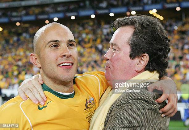 Marco Bresciano of Australia and John O'Neill CEO of Soccer Australia celebrate victory after the second leg of the 2006 FIFA World Cup qualifying...