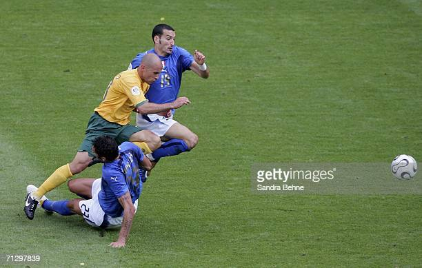 Marco Bresciano of Australia is brought down by Marco Materazzi of Italy, who recived a red card for this challenge during the FIFA World Cup Germany...