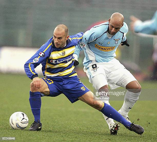 Marco Bresciano of Parma is tackled by Ousmane Dabo of Lazio during the match between Lazia and Parma at the Olympico Stadium on February 27 2005 in...