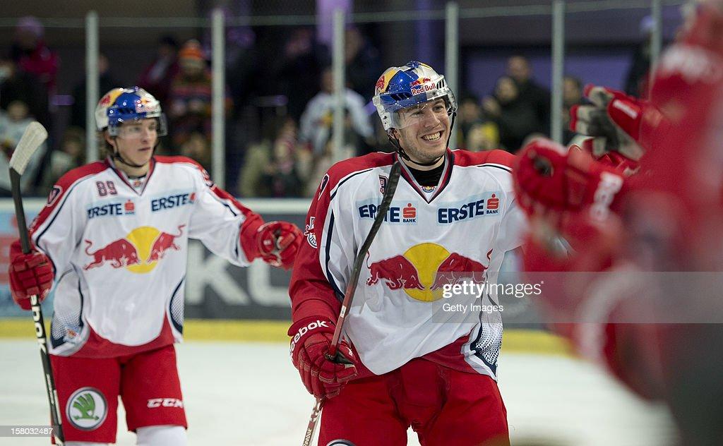 Marco Brucker (left) and Justin di Benedetto of Salzburg celebrate after a goal during the Erste Bank Eishockey Liga match between EC Red Bull Salzburg and HDD TELEMACH Olimpija Ljubljana at Eisarena Salzburg on December 9, 2012 in Salzburg, Austria.