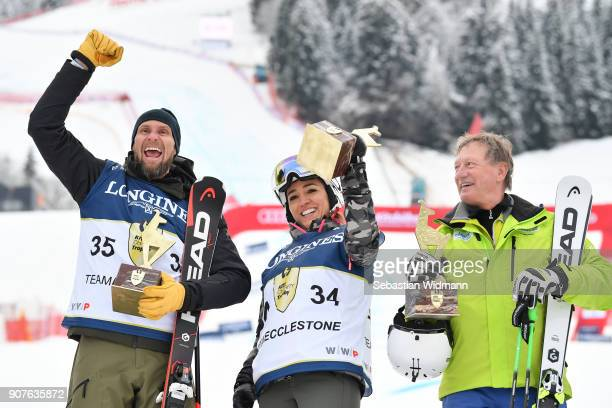 Marco Buechel , Fabiana Ecclestone and Franz Klammer pose for a picture during the victory ceremony of the KitzCharityTrophy on January 20, 2018 in...