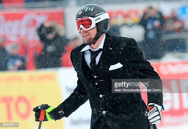 Marco Buechel of Liechtenstein celebrates his last race of his career during the Audi FIS Alpine Ski World Cup Men's Super G on March 11 2010 in...