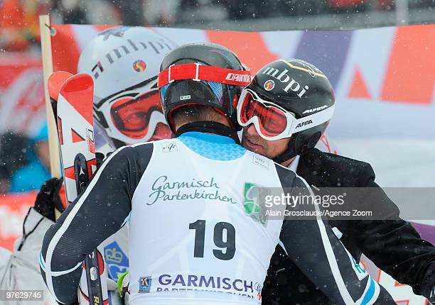 Marco Buechel of Liechtenstein celebrates his last race of his career with Aksel Lund Svindal of Norway during the Audi FIS Alpine Ski World Cup...