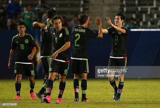 Marco Bueno of Mexico celebrates his second goal of the game against Costa Rica with teammate JoseCarlos Van Rankin in the second half during the...