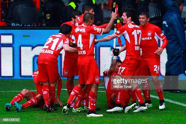 Marco Bueno of Toluca celebrates after scoring with teammates during a match between Toluca and Queretaro as part of 10th round Clausura 2015 Liga MX...