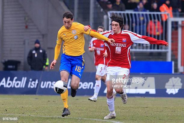 Marco Calamita of Braunschweig is challenged by Markus Schwabl of Unterhaching during the 3. Liga match between Eintracht Braunschweig and SpVgg...