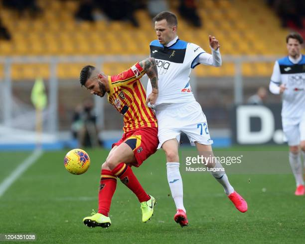 Marco Calderoni of Lecce competes for the ball with Josip Ilicic of Atalanta during the Serie A match between US Lecce and Atalanta BC at Stadio Via...