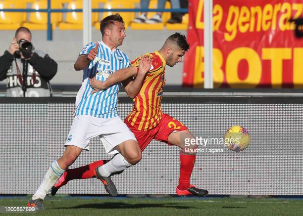 Marco Calderoni of Lecce competes for the ball with Thiago Cionek of Spal during the Serie A match between US Lecce and SPAL at Stadio Via del Mare...