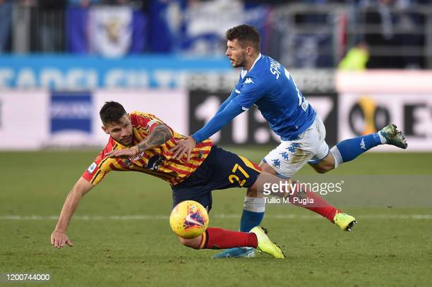 Marco Calderoni of Lecce is tackled by Nikolas Spalek of Brescia during the Serie A match between Brescia Calcio and US Lecce at Stadio Mario...