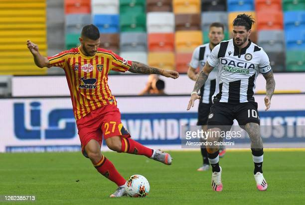 Marco Calderoni of US Lecce and Rodrigo De Paul of Udinese Calcio during the Serie A match between Udinese Calcio and US Lecce at Stadio Friuli on...