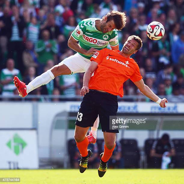 Marco Caligiuri of Greuther Fuerth jumps for a header with Ronny Koenig of Darmstadt during the Second Bundesliga match between SpVgg Greuther Fuerth...