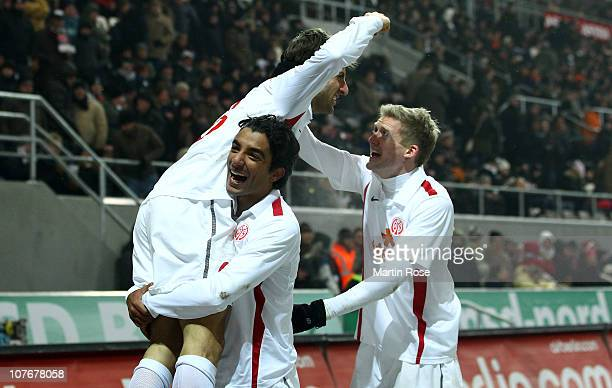Marco Caligiuri of Mainz celebrates with his team mates after he scores his team's 4th goal mduring the Bundesliga match between FC St Pauli and FSV...