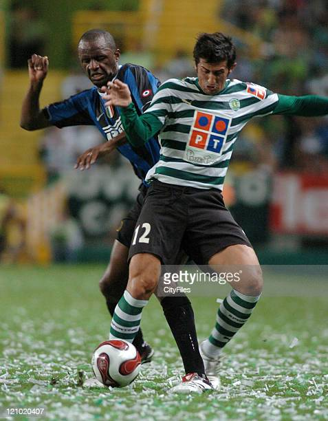 Marco Caneira of Sporting holds the ball from Patrick Viera of Inter Milan during the 100th anniversary match between Sporting Lisbon and Inter Milan...