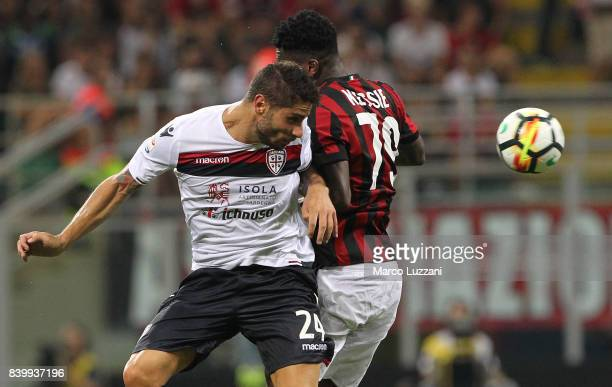 Marco Capuano of Cagliari Calcio competes for the ball with Franck Kessie of AC Milan during the Serie A match between AC Milan and Cagliari Calcio...