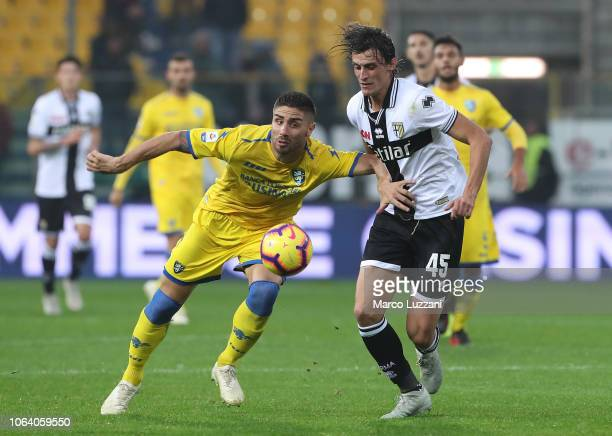 Marco Capuoano of Frosinone Calcio competes for the ball with Roberto Inglese of Parma Calcio during the Serie A match between Parma Calcio and...