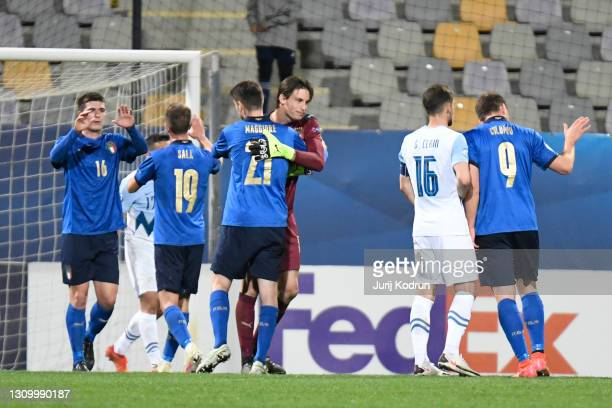 Marco Carnesecchi of Italy celebrates victory with team mate Giulio Maggiore following the 2021 UEFA European Under-21 Championship Group B match...