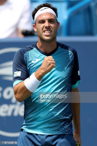 Marco Cecchinato of Italy celebrates a point against Alex de Minaur of Australia during Day 2 of the Western and Southern Open at Lindner Family...