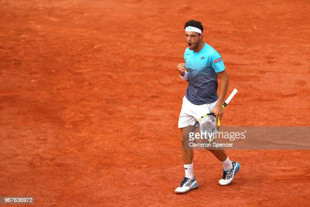 Marco Cecchinato of Italy celebrates during the mens singles quarter finals match against Novak Djokovic of Serbia during day ten of the 2018 French...