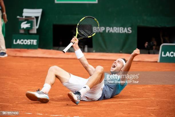 Marco Cecchinato of Italy celebrates his quarter finals win against Novak Djokovic of Serbia on Court Suzanne Lenglen in the Men's Singles...
