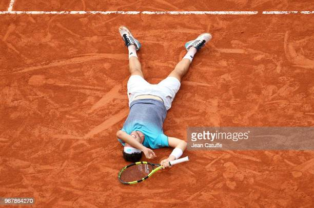 Marco Cecchinato of Italy celebrates his victory over Novak Djokovic of Serbia during Day 10 of the 2018 French Open at Roland Garros stadium on June...