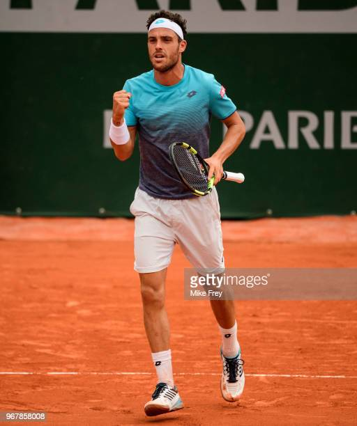 Marco Cecchinato of Italy celebrates in the fourth set against Novak Djokovic of Serbia in the Quarter Finals of the men's singles during the French...