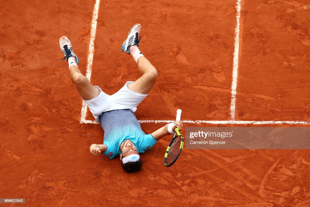 Marco Cecchinato of Italy celebrates victory during the mens singles fourth round match against David Goffin of Belgium during day eight of the 2018 French Open at Roland Garros on June 3, 2018 in Paris, France.