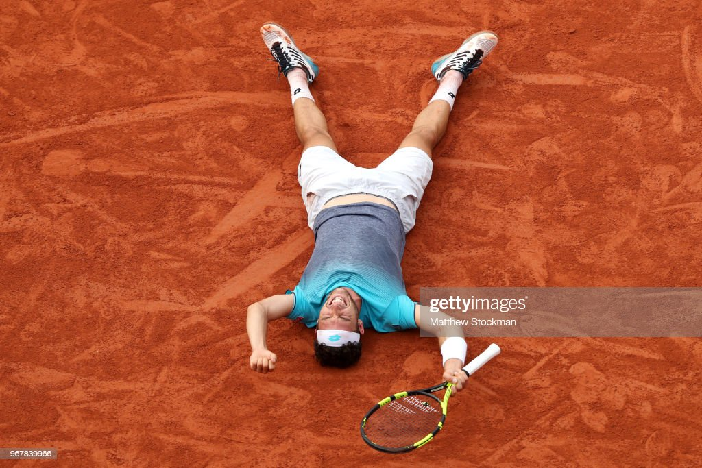Marco Cecchinato of Italy celebrates victory during the mens singles quarter finals match against Novak Djokovic of Serbia during day ten of the 2018 French Open at Roland Garros on June 5, 2018 in Paris, France.