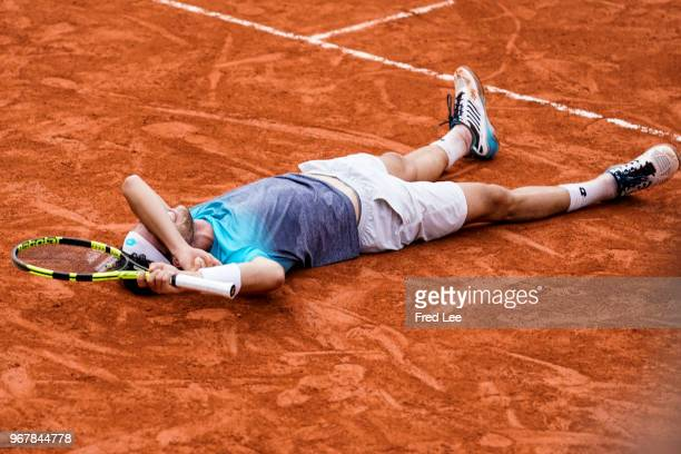 Marco Cecchinato of Italy celebrates victory during the mens singles quarter finals match against Novak Djokovic of Serbia during day ten of the 2018...