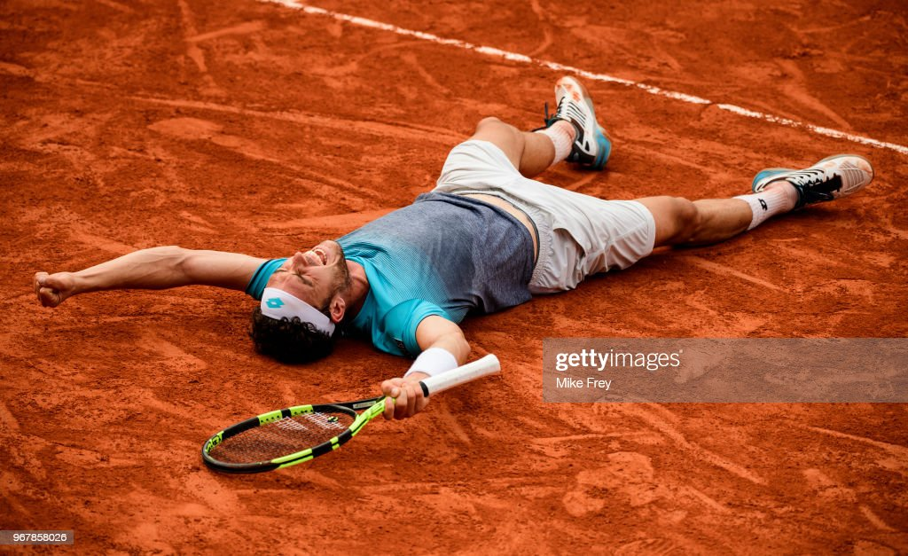 Marco Cecchinato of Italy celebrates victory over Novak Djokovic of Serbia 6-3 7-6 1-6 7-6 in the Quarter Finals of the men's singles during the French Open at Roland Garros on June 5, 2018 in Paris, France.