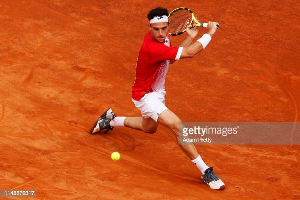 Marco Cecchinato of Italy chases down a ball during his first round match against Alex De Minaur of Australia during day two of the International BNL...