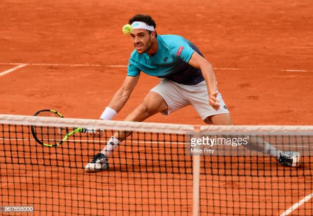 Marco Cecchinato of Italy hits a forehand against Novak Djokovic of Serbia in the Quarter Finals of the men's singles during the French Open at...