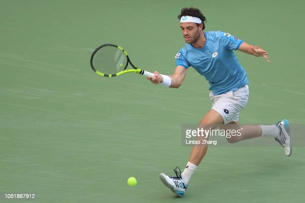 Marco Cecchinato of Italy hits a return against Novak Djokovic of Serbia during they third round of the 2018 Rolex Shanghai Masters on Day 5 at Qi...