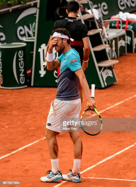 Marco Cecchinato of Italy is overcome with emotion after defeating Novak Djokovic of Serbia 6-3 7-6 1-6 7-6 in the Quarter Finals of the men's...