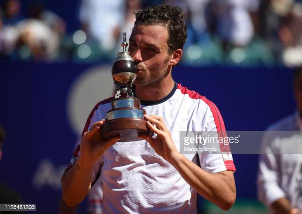 Marco Cecchinato of Italy kisses the trophy after winning the Argentina Open ATP 250 against Diego Schwarztman of Argentina during the final day of...