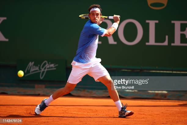 Marco Cecchinato of Italy plays a backhand against Guido Pella of Argentina in their third round match during day five of the Rolex Monte-Carlo...