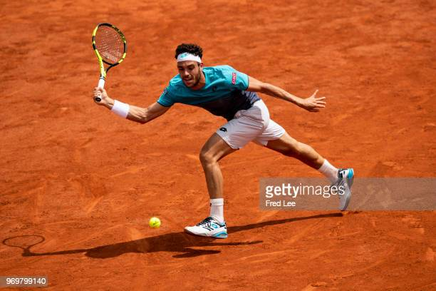 Marco Cecchinato of Italy plays a forehand during the mens singles semifinal match against Dominic Thiem of Austria during day thirteen of the 2018...