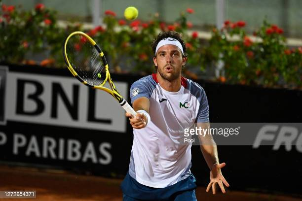 Marco Cecchinato of Italy plays a forehand in his round one match against Kyle Edmund of Great Britain during day two of the Internazionali BNL...